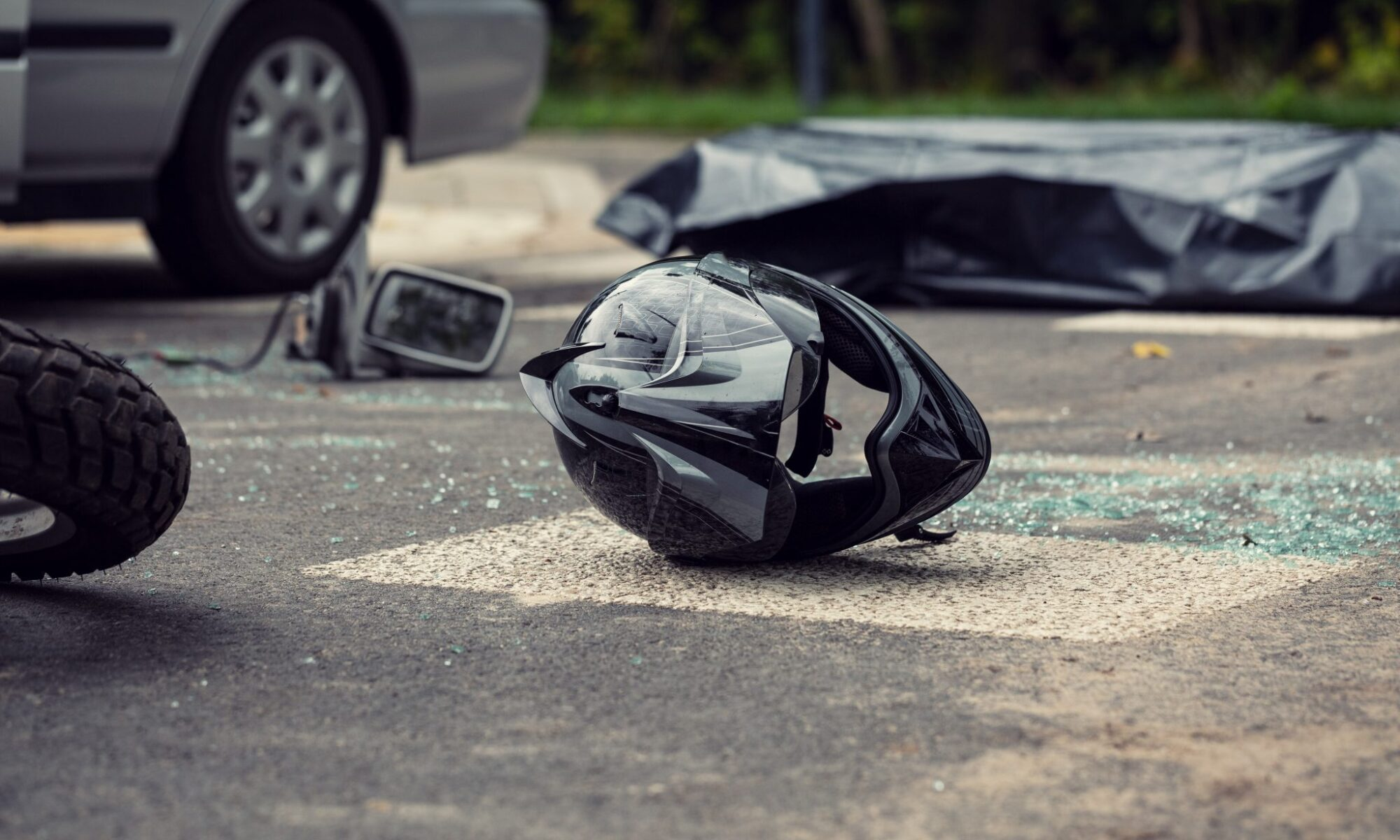 Motorcycle helmet on the road after crash